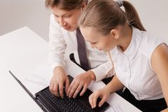Overhead closeup of business couple using laptop Royalty Free Stock Image