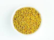 Overhead closeup of yellow and orange Australian bee pollen. On white background royalty free stock photo