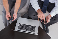 Overhead of colleagues using their mobile phone Stock Photos