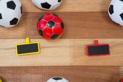 Colorful footballs on wooden table Stock Photography