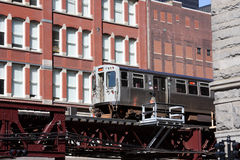 Overhead commuter train in Chicago. Elevated commuter train in Chicago. The El Stock Photography