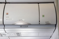 Overhead compartment. Airplane cabin interior stock photography