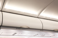 Overhead compartment in commercial aircraft. Royalty Free Stock Image