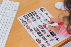 Overhead of contact sheet being edited Royalty Free Stock Photo