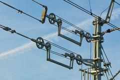 Overhead contact wires of electrified railway tracks kept under tension. Transport royalty free stock photo