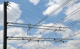 Overhead contact wires of a trolley car. Aerial lines of a streetcar fixed at a metal pylon providing energy for tramway Stock Images