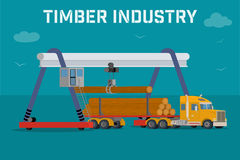 Overhead crane loads a logs in the truck. Royalty Free Stock Images