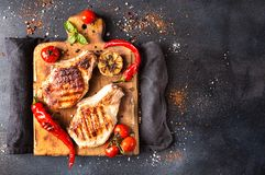 Overhead of dinner table. Delicious grilled barbecue pork meat o Royalty Free Stock Photography