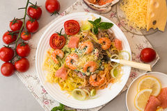 Overhead of dinner table. Pasta tagliatelle with grilled shrimps Royalty Free Stock Images