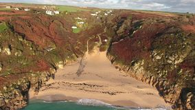 Drone footage of Porthcurno beach and cove, panning out and around open air theatre stock footage