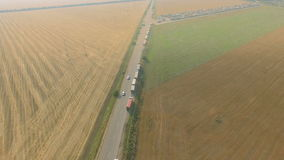 Overhead drone footage of transport network trucks shipping, supply chain. At highway stock footage