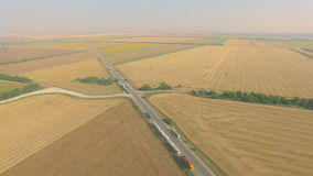 Overhead drone footage of transport network trucks shipping, supply chain. At highway stock video footage