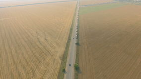 Overhead drone footage of transport network trucks shipping, supply chain. At highway stock video