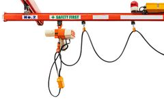 Overhead electric chain hoist with hook remote switch control isolated on white background with clipping path.  royalty free stock photography