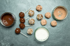 Overhead of Energy Balls, Melted and Powder Chocolate, and Coconut stock images