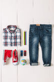 Overhead of essentials casual boy. Royalty Free Stock Photo