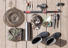 Overhead of essentials for fisherman. Fshing tackle and equipmen Stock Images