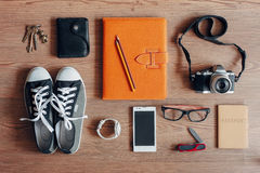 Overhead of essentials for modern young person. Outfit of traveler, student, teenager, young woman or guy. Overhead of essentials for modern young person Royalty Free Stock Image