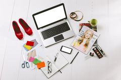 Overhead of a essentials objects in a fashion blogger. Still life of a fashion creative space Royalty Free Stock Photography