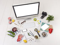 Overhead of the essentials objects of a foodie girl. Food blogger objects on workspace Stock Image