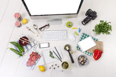 Overhead of the essentials objects of a foodie girl. Food blogger objects on workspace Stock Photography