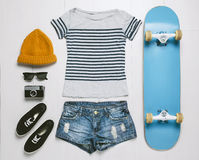 Overhead of essentials skater woman. Royalty Free Stock Photography