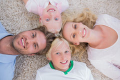 Overhead of family lying in a circle Stock Photos