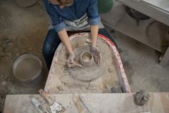 Overhead of female potter molding a clay Royalty Free Stock Photo