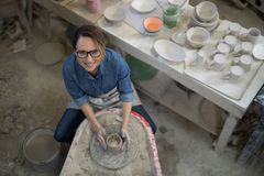 Overhead of female potter molding a clay Royalty Free Stock Photography