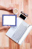 Overhead of feminine hands holding tablet and coffee Stock Photography