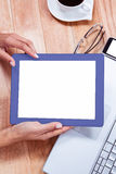 Overhead of feminine hands holding tablet Royalty Free Stock Photo
