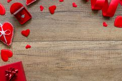Overhead flat lay valentine day, romantic suggestions background. Red hearts, jewelery box with ring and ribbon on wood. Shabby background. Copy space royalty free stock photography