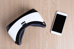 Overhead flat lay view of virtual reality headset and smartphone Stock Images