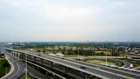 Overhead flyover the complex road junction highway. Sunny day, Thailand road, sunset. High altitude drone flight. Ultrahd 4K stock video