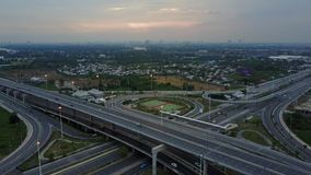 Overhead flyover the complex road junction highway. Sunny day, Thailand road, sunset. High altitude drone flight. Ultrahd 4K stock footage