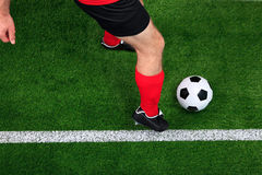 Overhead football player dribbling stock photos