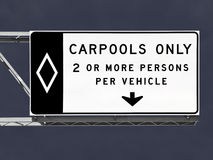 Overhead Freeway Carpool Only Sign with Storm Sky Royalty Free Stock Images