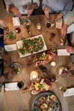 Overhead of friends dining together. In restaurant Stock Image