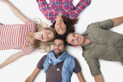 Overhead of friends lying in a circle Stock Photo