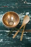 Golden steel bowl, spatula and spoon on table Stock Images
