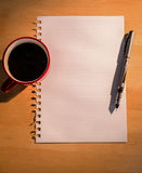Overhead of graph paper coffee and pen Royalty Free Stock Photography