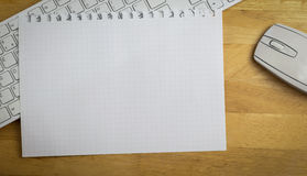 Overhead of graph paper on keyboard Royalty Free Stock Photography
