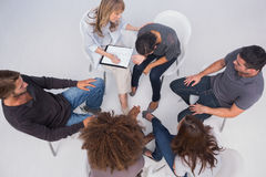Overhead of group therapy session. With one women crying Stock Photography