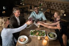 Overhead of happy friends toasting wine Royalty Free Stock Photo