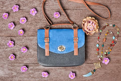 Overhead hipster stylish essentials, flowers Royalty Free Stock Images
