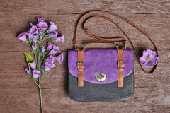 Overhead hipster stylish essentials, flowers. Overhead outfit Fashion ladies accessories. Glamor creative hipster look, pastel colors. Stylish handbag, bouquet Stock Photography