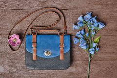 Overhead hipster stylish essentials, flowers. Overhead outfit Fashion ladies accessories. Glamor creative hipster look, pastel colors. Stylish handbag, bouquet Royalty Free Stock Images