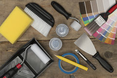 Overhead of Home Improvement Painting Equipment on Wooden Surfac. Overhead shot of home improvement painting equipment on a wooden background Stock Image