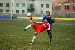 Overhead kick Stock Photo