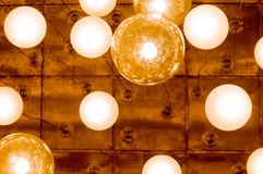 Overhead lights in the form of lit globes Stock Photos
